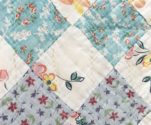 Hand quilted vintage close up